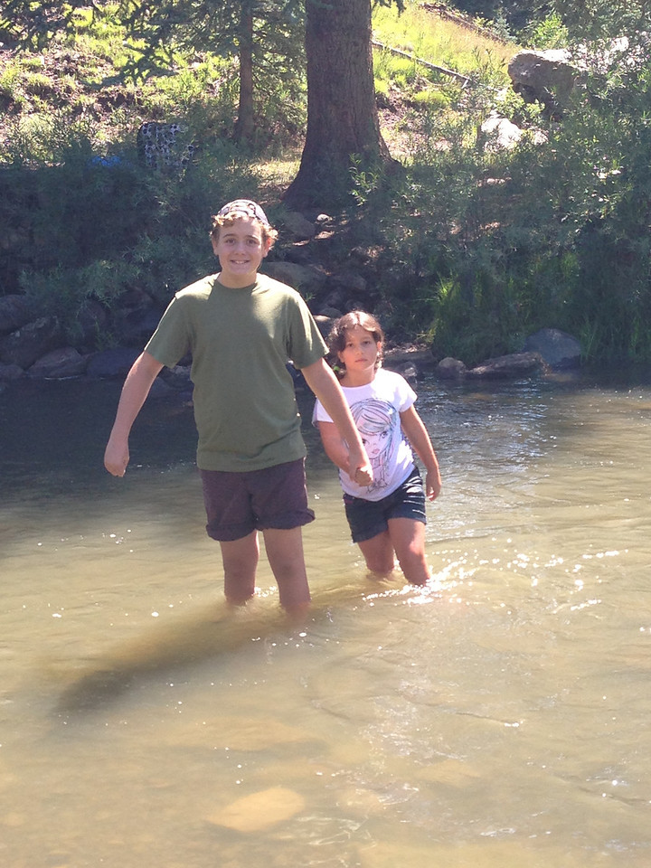 Wading in Williams Creek along the Piedra River Trail