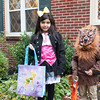 131030 trick-or-treating JOED VIERA/STAFF PHOTOGRAPHER Lockport, NY-Trick or Treating cousins Jeter Serano dressed as the Wolfman and Gillian Rasario dressed as Minnie Mouse after getting candy from a house on Thursday Oct 31st, 2013.