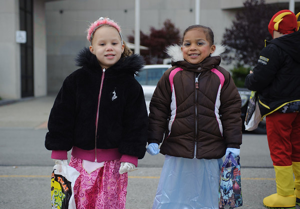 131025 Halloween JOED VIERA/STAFF PHOTOGRAPHER Lockport, NY-Dressed as Disney Princesses Aurora and Cinderella Avyonna Mcgiverly (4) (left) and Amirah Bennett (4) (right) wait in line for pizza and treats in front of City Hall on Friday October 25th, 2013.