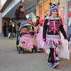 131025 Halloween JOED VIERA/STAFF PHOTOGRAPHER Lockport, NY- Mya Dietz (7) dressed as a Zebra Skeleton walks down Main street in search of treats on Friday October 25th, 2013.
