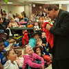 131030 Halloween Party JOED VIERA/STAFF PHOTOGRAPHER Lockport, NY- Children watch magician Mike Joseph perform at the halloween party at Odd Fellows Nursing Home on Wednesday Oct 30th, 2013.