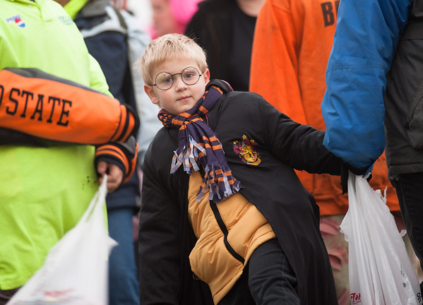 131025 Halloween JOED VIERA/STAFF PHOTOGRAPHER Lockport, NY-An unidentified Harry Potter waits line during the annual event put on by the city and and Lockport Main St. Inc. on Friday October 25th, 2013.