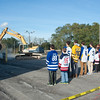 131029 Ice Rink JOED VIERA/STAFF PHOTOGRAPHER Lockport, NY- Local hockey players watch as the crane starts the demolition of the site of the future Ice & Sports Arena on Tuesday Oct 29th, 2013.