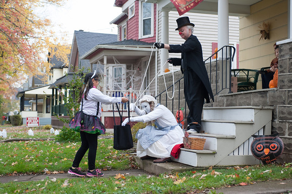 131030 trick-or-treating JOED VIERA/STAFF PHOTOGRAPHER Lockport, NY-Trick or Treater Alicia Rivera dressed as a nerdy Hello Kitty gets candy from Marionette Karen Eichler and Puppetmaster Andy Spragge on Thursday Oct 31st, 2013.