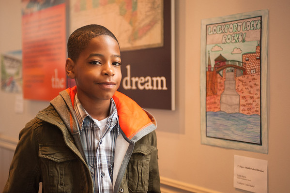 131026 Canal Aniversary JOED VIERA/STAFF PHOTOGRAPHER Lockport, NY- Caleb Harris (12) a 7th grader at Gaskill Prep School and winner of the Erie Canal Discovery Center poster contest in front of his award winning poster at the ECDC on Saturday October 26th, 2013.