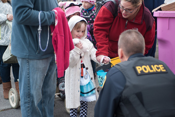 131025 Halloween JOED VIERA/STAFF PHOTOGRAPHER Lockport, NY-An unidentified child dressed as Alice is offered candy during the annual event put on by the city and and Lockport Main St. Inc. on Friday October 25th, 2013.