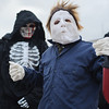 131025 Halloween JOED VIERA/STAFF PHOTOGRAPHER Lockport, NY-Dressed the Grimm Reaper (Kyle Meness) and Michael Myers( Kobe Meness) wait in line for pizza and treats in front of City Hall on Friday October 25th, 2013.
