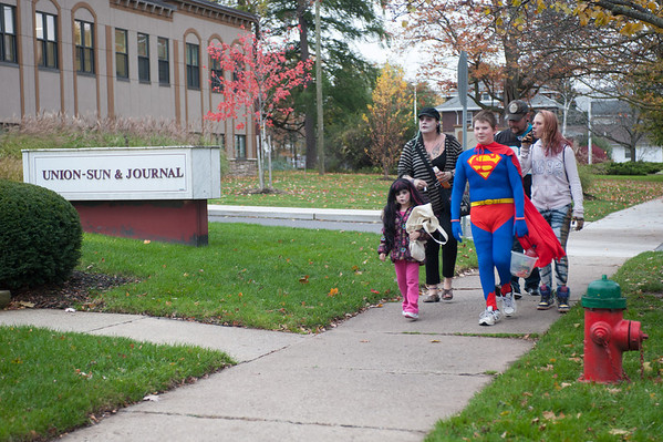 131030 trick-or-treating JOED VIERA/STAFF PHOTOGRAPHER Lockport, NY-Trick or Treater's pass the Union-Sun and Journal's Building on Thursday Oct 31st, 2013.
