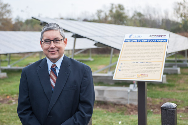 131030 Solar Store JOED VIERA/STAFF PHOTOGRAPHER Lockport, NY- Reid Group President Paul Quebral stands infront of the new solar array system outside of Crosby's Wednesday Oct 30th, 2013.