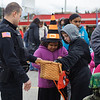131025 Halloween JOED VIERA/STAFF PHOTOGRAPHER Lockport, NY-Children  grab candy from Officer Pittman while in line during the annual event put on by the city and and Lockport Main St. Inc. on Friday October 25th, 2013.