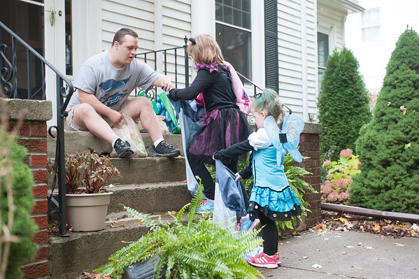 131030 trick-or-treating JOED VIERA/STAFF PHOTOGRAPHER Lockport, NY-Trick or Treating siblings Carleigh Bull a cat and Kierra McClaine a butterfly  open their bags for candy at Micheal's house on Thursday Oct 31st, 2013.