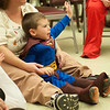 131030 Halloween Party JOED VIERA/STAFF PHOTOGRAPHER Lockport, NY- Xavier Howard (3) raises his hand to volunteer for a trick magician Mike Joseph will perform at the halloween party at Odd Fellows Nursing Home on Wednesday Oct 30th, 2013.