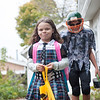 131030 trick-or-treating JOED VIERA/STAFF PHOTOGRAPHER Lockport, NY-Trick or Treating siblings Makayla Parker a monster high monster and her brother Brad Parker a zombie football player walk away from a house on  Thursday Oct 31st, 2013.