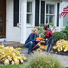 131030 trick-or-treating JOED VIERA/STAFF PHOTOGRAPHER Lockport, NY-Anne McCafferey gives out candy to trick or treater Dylan Gullo dressed as Darth Maul at her home on Thursday Oct 31st, 2013.