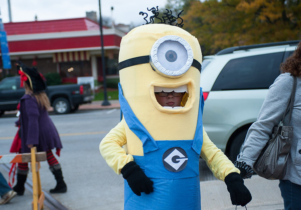 131025 Halloween JOED VIERA/STAFF PHOTOGRAPHER Lockport, NY- Dylan Macer (9) dressed as a minion trick or treating during the annual event put on by the city and and Lockport Main St. Inc. on Friday October 25th, 2013.