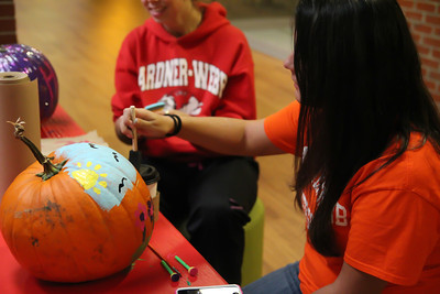 Students Celebrate the Autumn Season by decorating pumpkins.