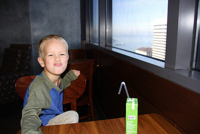 Connor and I sipping coffee and apple juice at the world's highest Starbucks (40th floor)