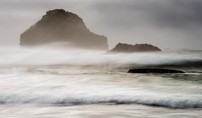 Face rock through the fog.