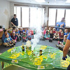 Villard Djemson (Salisbury, Md.), Chrystian Banuelos (Pomona, Calif.), and Marisa Maher (Edmond, Okla.) put on a science demonstration for York General Childcare.
