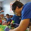 "Villard Djemson (Salisbury, Md.), Chrystian Banuelos (Pomona, Calif.), and Marisa Maher (Edmond, Okla.) put on a science demonstration for York General Childcare. <br /> In this picture Alex volunteers to help with the ""genie in the bottle"" experiment."