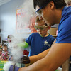 "Villard Djemson (Salisbury, Md.), Chrystian Banuelos (Pomona, Calif.), and Marisa Maher (Edmond, Okla.) put on a science demonstration for York General Childcare.<br /> In this picture Alex volunteers to help with the ""genie in the bottle"" experiment."