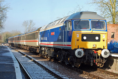 The previous night's snowfall is still evident at Thuxton as 47596 awaits the arrival of a Dereham-bound train (09/02/2013)