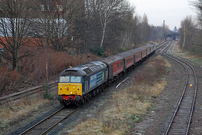 The following day I gambled on the sun reappearing but wasn't successful. 47501 'Craftsman' is seen approaching Heaton Norris with 5Z45 0900 Crewe DMD to Stoke Sideways Loop. Just visible in the gloom on the rear of the train is 47853, which had taken over from 818 for the remainder of the week (16/01/2013)