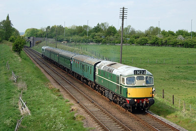 27056 disturbes the Sunday afternoon tranquility as it thrashes past Woodthorpe with 2C34 1540 Loughborough - Rothley Brook (19/05/2013)