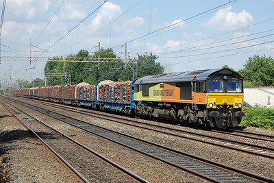 66849 approaches Levenshulme with the diverted 6J37 Carlisle to Chirk log train, which was rerouted through central Manchester during a nine-day engineering blockade of the WCML at Wigan (18/07/2013)