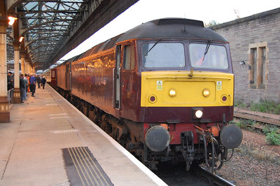 It's nearly 22 years since I last had a pair of '47s' in tandem over the Highland Main Line, but here 47804 + 47826 await departure from Perth with Compass Tours' 1Z37 0659 Hereford - Inverness 'Autumn Highlander' land-cruise. The former is restricted to 75 mph because of wheelset issues, and has spent most of the year on the 'Royal Scotsman', but had just been added to the front of the train to act as the spare loco for the weekend (18/10/2013)