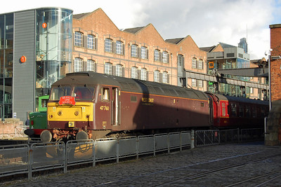 47760 waits to depart from MoSI with the return BLS charter to Carnforth. The backdrop of 21st Century steel/glass and 19th Century warehousing is certainly a striking one (03/11/2013)