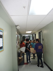 Families and current students helped to move from older classrooms into the new building.