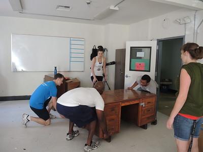 How many Penn Alumni does it take to lift a very heavy desk?