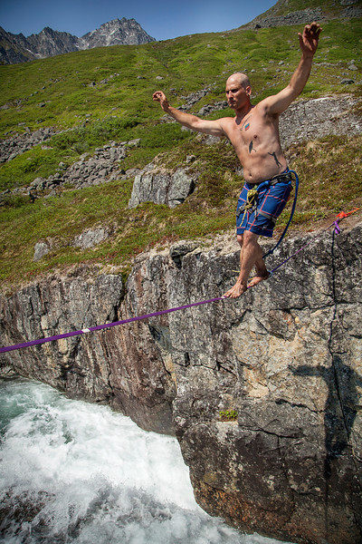 """Halfway across, Dave is about to complete the """"full-man"""" send of the Reed Creek Highline."""