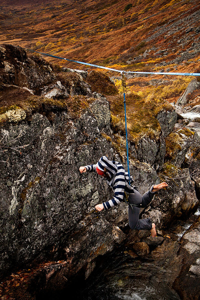 The leash stretches as Emily loses her hold on the line during a fall.