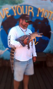 Our airboat captain holds an alligator