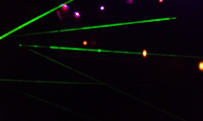 "Craig and Ellen play ""Red Planet Laser Challenge,"" which requires crawling over and under laser beams to reach targets"
