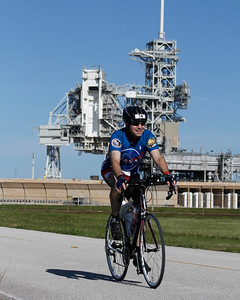 Craig passes Launch Pad LC-39A on the bike course. (Courtesy of Michael R. Brown Photography)