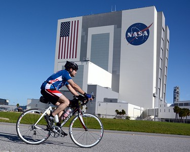 Craig passes the Vehicle Assembly Building on the bike course. (Courtesy Craig Bailey Photography)