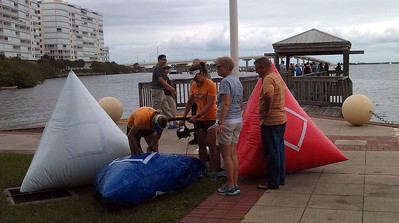 Volunteers inflate buoys for the three race lengths