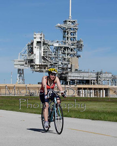 Ellen passes Launch Pad LC-39A on the bike course