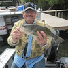 DEAN WITH A DECENT BASS ON THE YAHARA RIVER (LAKE KEGONSA) TOSSING WORMS TO THE BLUEGILLS   MAY 2013