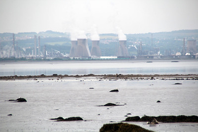 Grangemouth Ineos Oil Refinery, taken from across the river on Longannet River Banks. If you look closely you can see the 4 wheel tanks lined up underneath the cooling towers. 21/06/13.