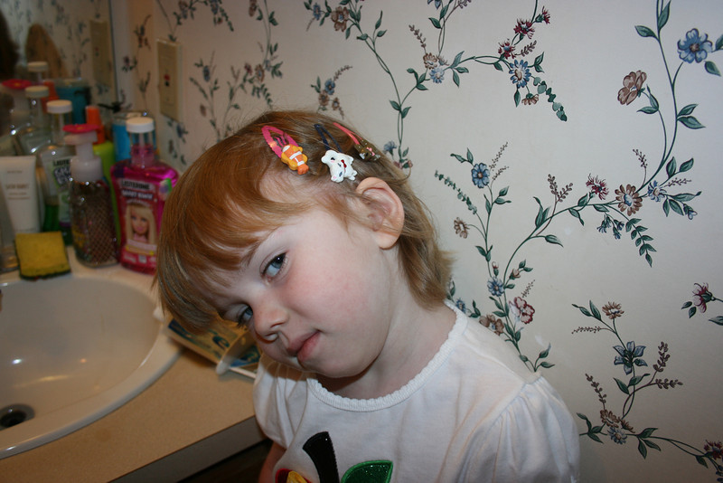 Gracie insisted on 3 hair clips on each side.