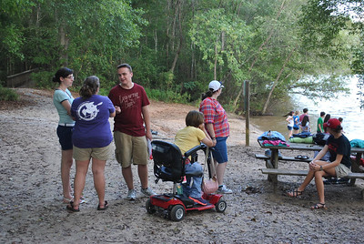 Students hang out by the river during the honors back to school picnic.