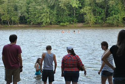 Students hang out in the river during the honors back to school picnic.