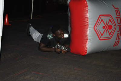 Students participate in a game to laser tag.