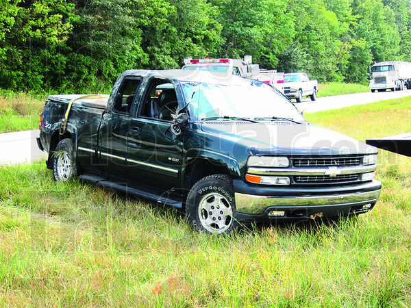 Rolled over: This Chevy Silverado came to rest upside down Wednesday afternoon along U.S. 41 in Pimento. The driver walked away from the crash.<br /> Tribune-Star/Arthur Foulkes