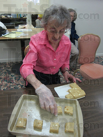 Rosie Halter, a resident of Cannon Inn, carefully places cookie dough in a baking pan Wednesday morning. Residents baked cookies and made a card, later delivered to Terre Haute Fire Station 7 at Fort Harrison Road and 13th Street. The residents and staff wanted to show their appreciation to the firefighters.