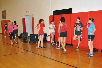 Students taking a water break during a Zumba fitness class.